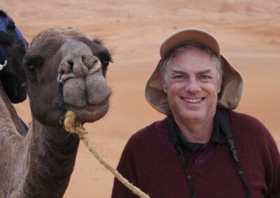 2009 Morocco Sahara Desert John and new friend smiling for the Camera -Bluyonda